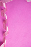 Overhead view of curled up Breast Cancer Awareness ribbon Stock Images