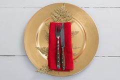 Cutlery with napkin and christmas decoration in a plate. Overhead view of cutlery with napkin and christmas decoration in a plate Stock Photos