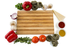 Overhead view of cutting board amidst various vegetables Stock Photo