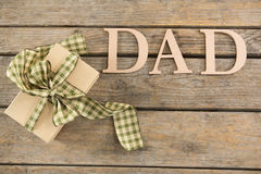 Overhead view of dad text with gift box Royalty Free Stock Photography