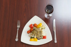 Overhead view of delicious fish dish with red wine Stock Images
