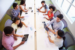 Overhead View Of Designers Meeting To Discuss New Ideas Stock Image