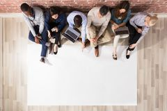 Overhead View Of Diverse People With Blank Paper royalty free stock photography