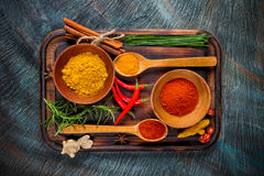Overhead view of dried spices in bowls Stock Photo