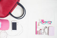 Overhead view of essential beauty items, Top view of smartphone, Royalty Free Stock Image