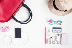 Overhead view of essential beauty items, Top view of smartphone, Royalty Free Stock Images