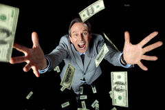 Overhead view of excited businessman catching dollar banknotes Royalty Free Stock Photo