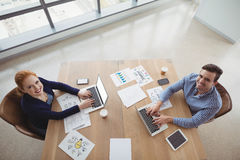 Overhead view of executives using laptop at desk Royalty Free Stock Photo