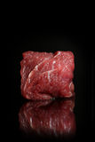 Overhead view eyes round beef meat on black background. Piece of fresh raw beef. Big piece of red meat on a dark textured ceramic background Stock Images