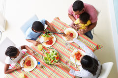 Overhead View Of Family Eating Meal Together. Overhead View Of Family Eating Meal Of Pasta Together Royalty Free Stock Photography