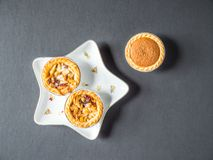 Overhead View Festive Christmas Star Shape Plate With Mince Pie Cup Cake on Dark Background Royalty Free Stock Photos