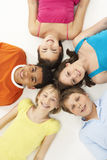 Overhead View Of Five Young Children In Studio stock images
