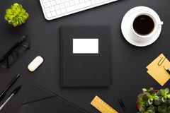 Folder With Label Surrounded By Office Supplies On Gray Desk Royalty Free Stock Image