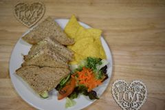 Overhead view of food photography with a healthy homemade lunch with tuna fish sandwich and side salad with love heart decorations. A home made lunch with canned Royalty Free Stock Photo