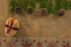 Overhead view of food tied with ribbon by pine cone and twigs. On burlap royalty free stock images