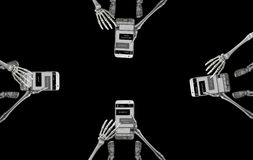 Skeletons Texting In Group. Overhead view of four cell phones being used by skeletons to message each other while together in one place Royalty Free Stock Photo