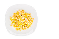 Overhead view of fresh corn maize kernels on plate Royalty Free Stock Image