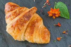 Overhead view of Fresh croissant on gray stone backgro Stock Photo