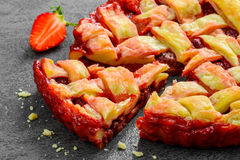 Overhead view of fresh strawberry pie or tart with Stock Photos
