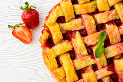 Overhead view of fresh strawberry pie or tart with Royalty Free Stock Image