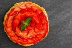 Overhead view of fresh strawberry pie or tart on Royalty Free Stock Photography