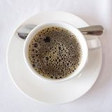 Overhead view of a freshly brewed mug of black coffee Royalty Free Stock Image