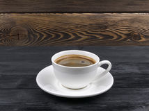 Overhead view of a freshly brewed mug of espresso coffee on rustic wooden background with woodgrain texture. Coffee break style Stock Photo