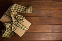 Overhead view of gift box on brown table Stock Photo