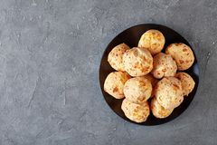 cheese puffs balls on a black plate royalty free stock images