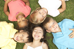 Overhead View Of Group Of Children Smiling At Camera Royalty Free Stock Images