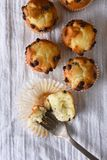 Overhead view of a group of mini chocolate chip muffins on a kitchen towel. royalty free stock images