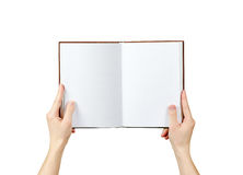 Overhead view of hands holding a blank book ready with copy spac royalty free stock images