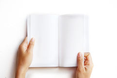 Overhead view of hands holding a blank book Royalty Free Stock Photos