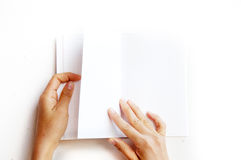 Overhead view of hands holding a blank book Stock Photos