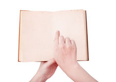 Overhead view of hands holding a old book  with copy space ready Royalty Free Stock Photo
