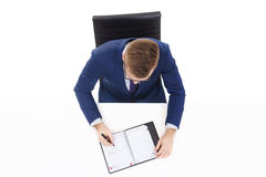 Overhead view of a handsome businessman with organizer in office. Business and office concept Royalty Free Stock Photos