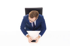 Overhead view of a handsome businessman with smartphone in office. Business and office concept Royalty Free Stock Photo