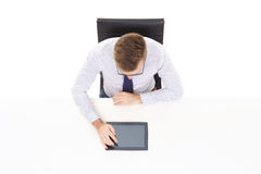 Overhead view of a handsome businessman working with tablet comp Royalty Free Stock Images