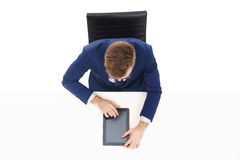 Overhead view of a handsome businessman working with tablet computer in office. Business and office concept Royalty Free Stock Photos
