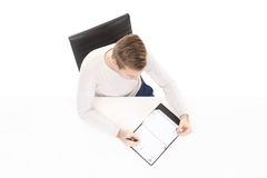 Overhead view of a handsome guy with organizer in office. Business and office concept Stock Photos