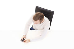 Overhead view of a handsome guy with smartphone in office. Business and office concept Stock Photos