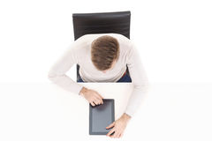Overhead view of a handsome guy working with tablet computer in office. Business and office concept.  Stock Photo