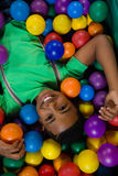 Overhead view of happy boy in ball pool royalty free stock photo