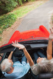 Overhead view of happy mature couple going for a ride together Royalty Free Stock Images