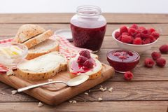 Overhead view on healthy breakfast with raspberry jam Royalty Free Stock Photo