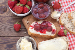 Overhead view on healthy breakfast with strawberry jam Royalty Free Stock Photo