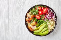 Chicken bowl with couscous, greens and veggies stock images