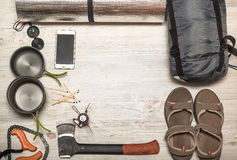 Overhead view of hiking gear on a wood floor. Gear include, comp Royalty Free Stock Images