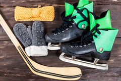 Overhead view of hockey ice skates accessories placed on old rus Stock Photos