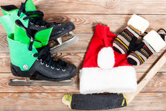 Overhead view of hockey ice skates accessories placed on old rus Royalty Free Stock Images